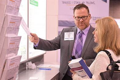 Product forum representative speaking with clinician at Pri-Med conference