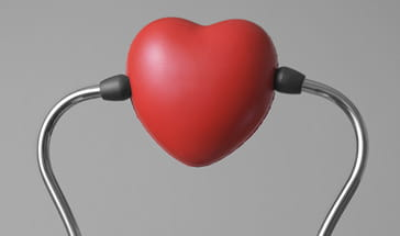 rubber heart placed between two ear sockets of a stethescope