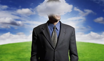 suited man with his head in a cloud