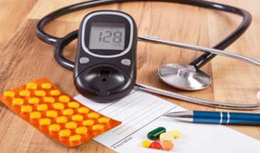Medical pills, tablets or supplements with prescription, glucometer and stethoscope